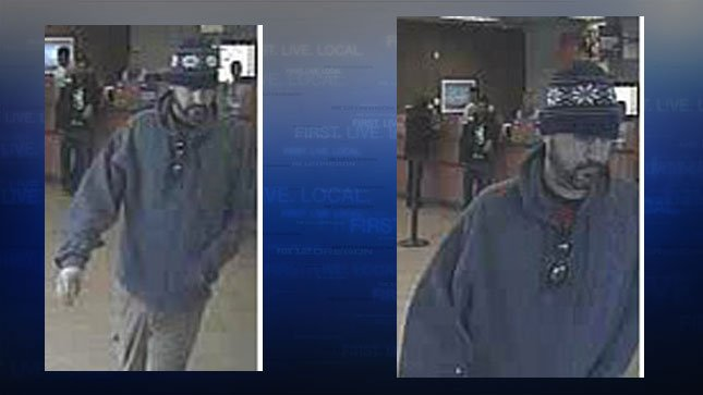 Vancouver Police describe the suspect in the US Bank robbery as a white man, in his late 30s to early 40s, wearing a blue knit beanie hat with white designs on it and a silver and blue jacket. (Vancouver PD/KPTV)