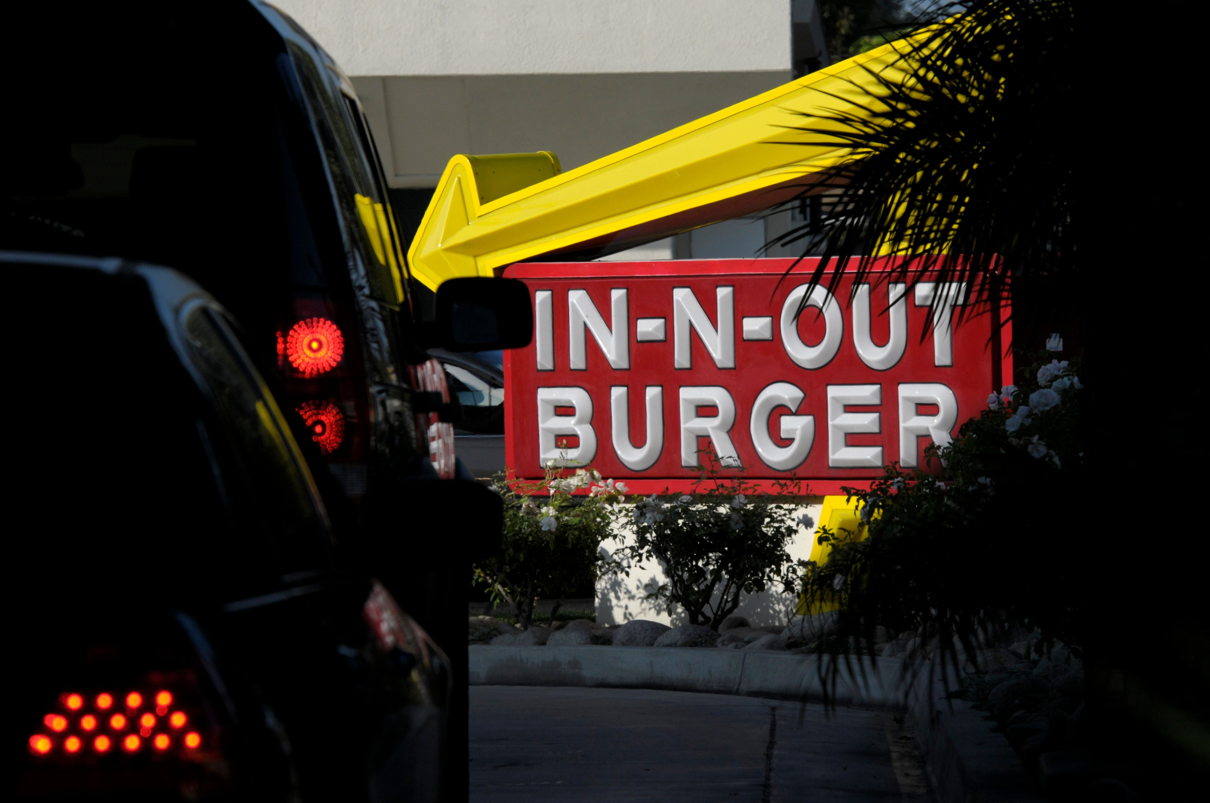 Cars line up in the drive-thru lane at In-N-Out Burger on Tuesday, June 8, 2010, in Baldwin Park, Calif. (AP Photo/Adam Lau)